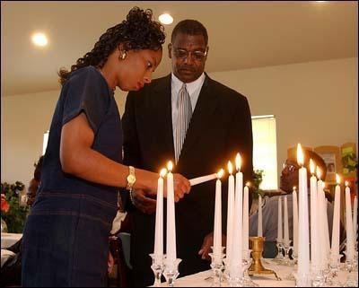 "Augusta Chronicle photo of a candlelight homage that was held to remember local homicide victims in Augusta during a National Crime Victim Rights Week breakfast sponsored by Augusta-based Blacks On Black Crime, Inc. that was taken for April 28, 2002 story entitled ""Service remembers local victims of violent crimes"" by Staff Writer Timothy Cox:"