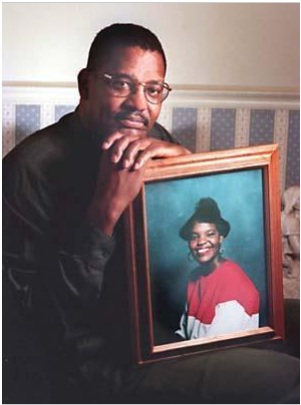 "Augusta Chronicle photo of activist Frank Howard, who is holding the photo of his daughter 17-year-old Phalonda Howard who was murdered nearly 6 years earlier in in July 1992 - and the photo is for a January 16, 1997 Augusta Chronicle story entitled ""Bill would keep suspects behind bars"" – Of course, Howard did not realize that he would be shot and wounded nearly 5 years after this photo was taken while he was an activist with Blacks Against Black Crime, Inc. and its future president."