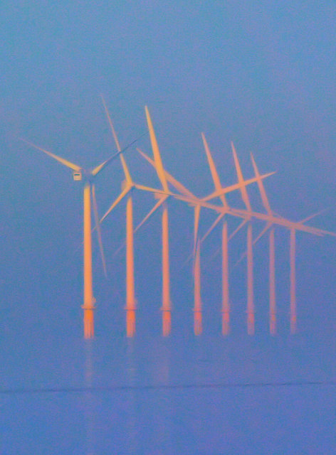 Off shore wind turbines bathed in mist and warm autumnal sunshine in Oct. 2007. The turbines are located on Burbo Bank about 4 miles offshore Photo from geograph.org.uk