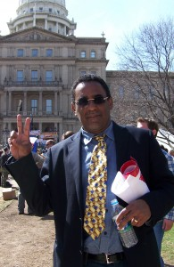 Voice of Detroit contributing editor Greg Thrasher at Lansing, Michigan rally April 13, 2011