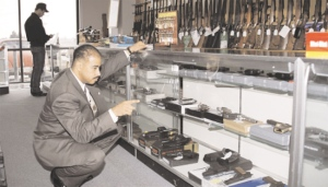 ATF inspector at a federally licensed gun dealer in ATF photo via Wikipedia